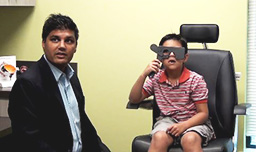 Dr. Bansal and a child during eye exam
